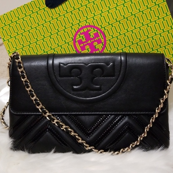 058dcae132ca Tory Burch Fleming Geo-leather clutch. M 5b95419e6a0bb7b4cbda4ae8